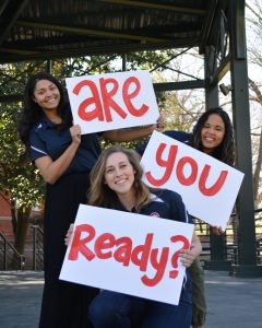 """students holding signs that say """"are you ready"""""""